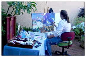 Here Jâree sits in the garden creating and painting with comfort.